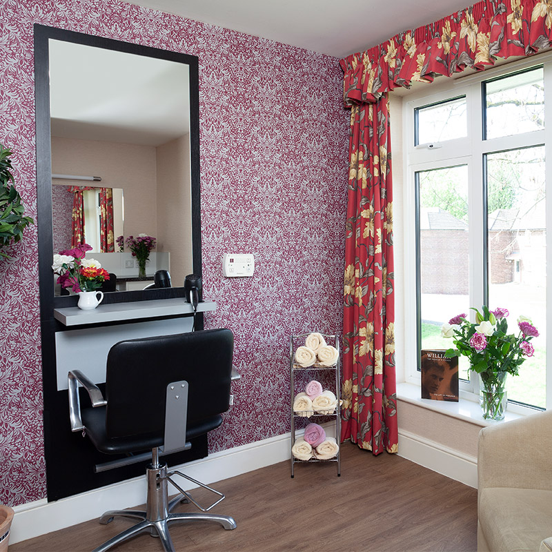 Corner of room with colourful wallpaper and curtain