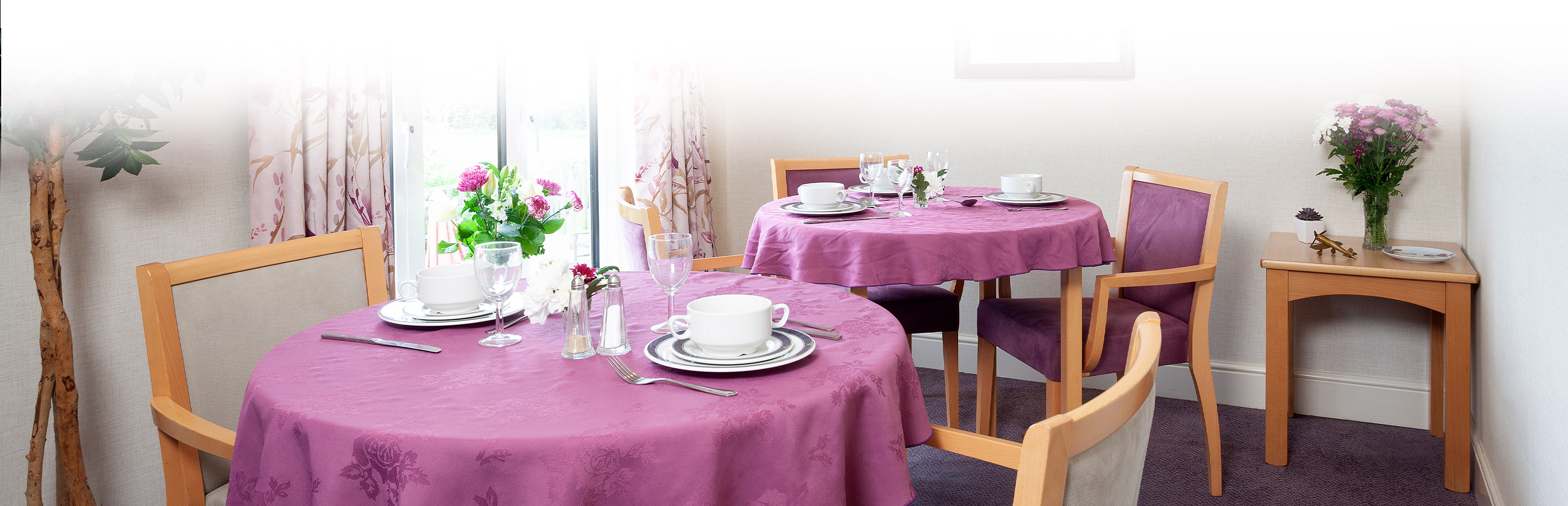 Purple table floral mat and tea pots on table at Stowford House Care Home Abingdon