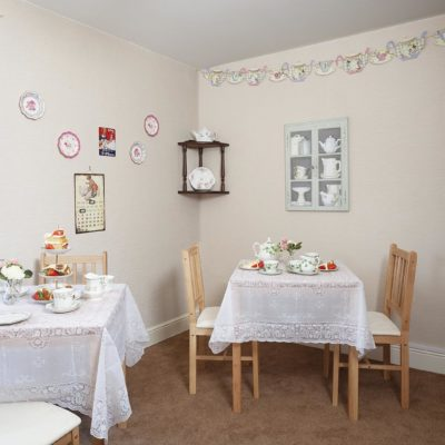 Table with tea pots at Stowford House Care Home Abingdon